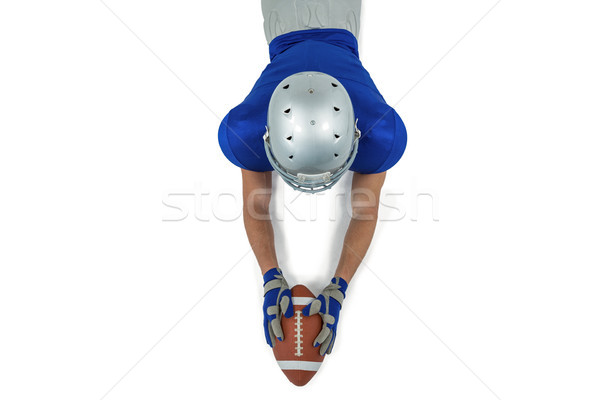 Rear view of American football player reaching towards ball Stock photo © wavebreak_media
