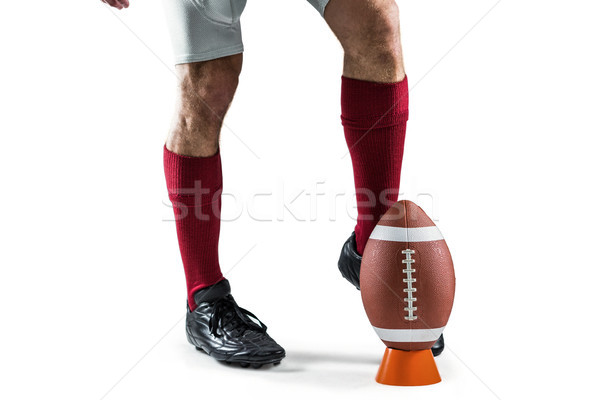 Low section of sportsman kicking ball Stock photo © wavebreak_media