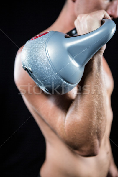 Midsection of shirtless athlete working out with kettlebell Stock photo © wavebreak_media