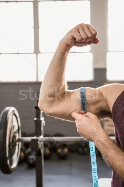 Kép férfi mér bicepsz tornaterem kéz Stock fotó © wavebreak_media