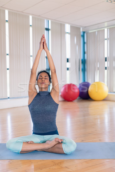 Woman performing yoga in the gym Stock photo © wavebreak_media