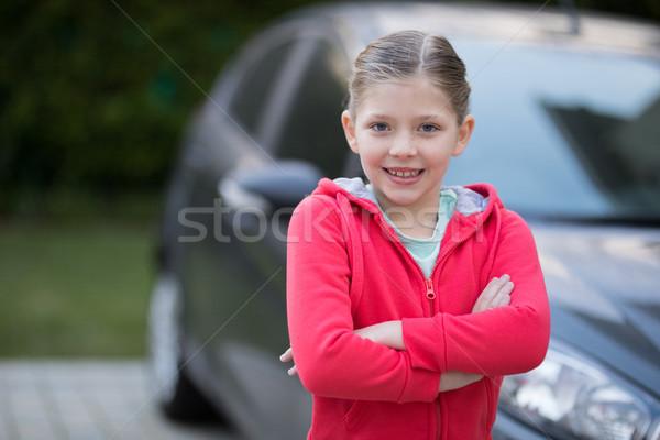 Teenage girl standing near the car Stock photo © wavebreak_media