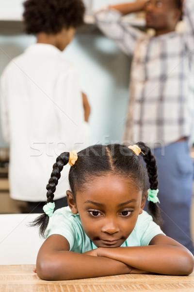 Stock photo: Sad girl against parents arguing