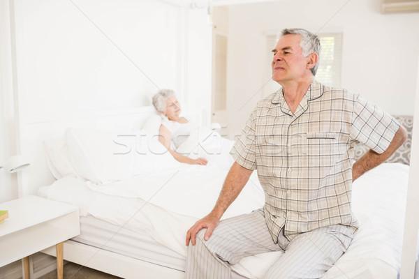 Suffering senior man holding his back Stock photo © wavebreak_media