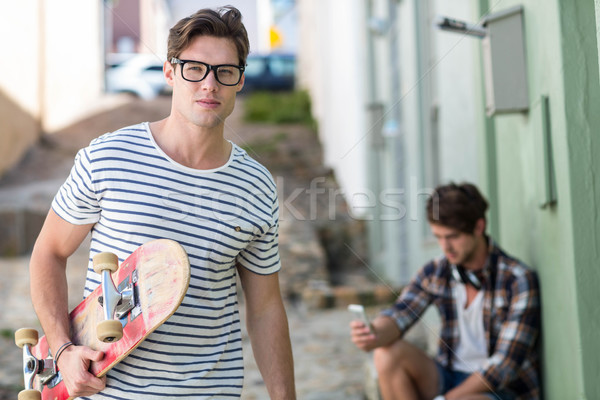 Cadera hombre skateboard mirando cámara Foto stock © wavebreak_media