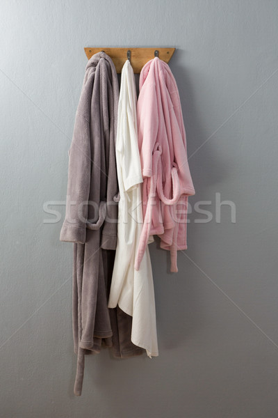Bathrobes hanging on hook Stock photo © wavebreak_media