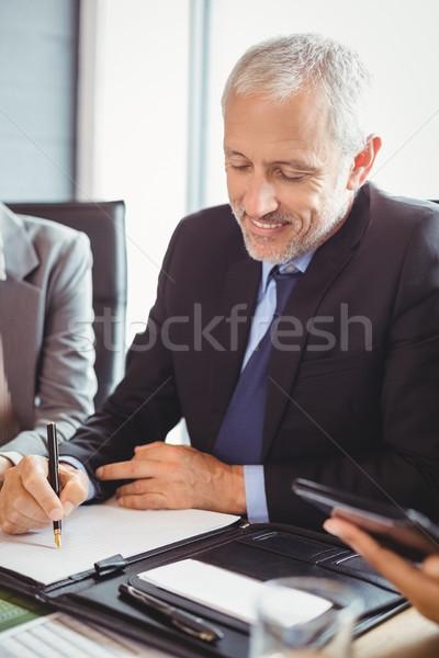 ビジネスマン 書く レポート 会議室 座って オフィス ストックフォト © wavebreak_media