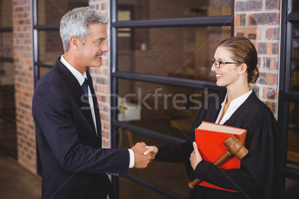 Mężczyzna kobiet prawnicy biuro szczęśliwy stałego Zdjęcia stock © wavebreak_media