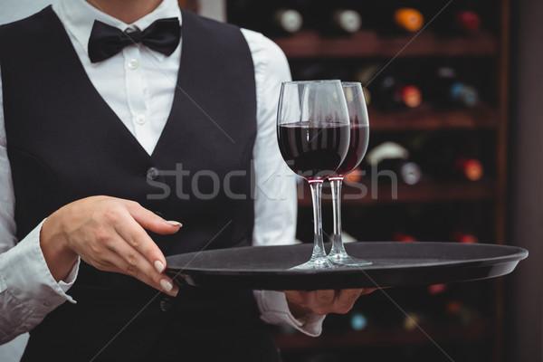 Garçonete bandeja óculos vinho tinto adega Foto stock © wavebreak_media