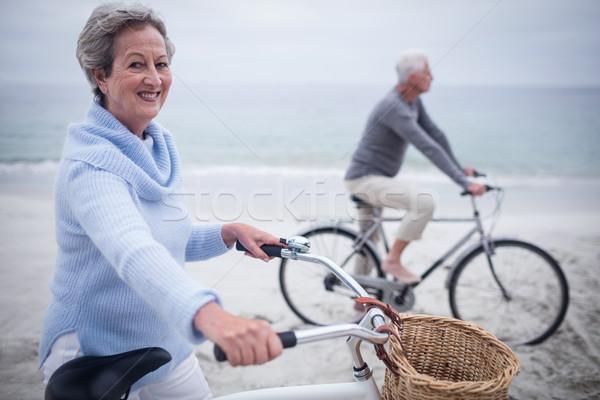 Bike spiaggia donna felice viaggio Foto d'archivio © wavebreak_media