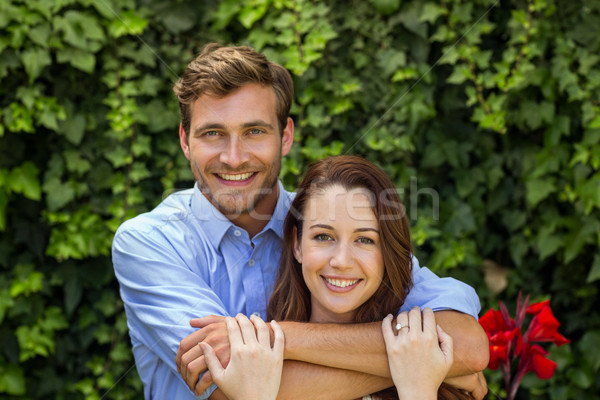 Portrait of couple hugging at front yard Stock photo © wavebreak_media
