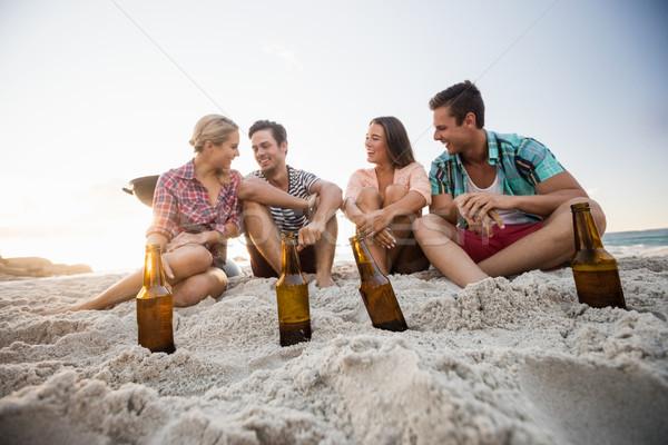 Smiling friends sitting Stock photo © wavebreak_media