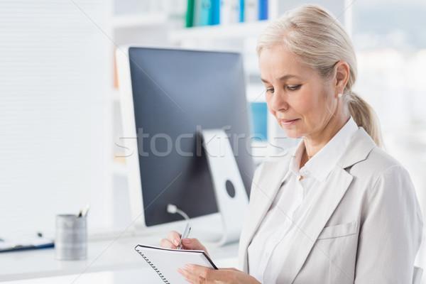 Female therapist writing notes Stock photo © wavebreak_media