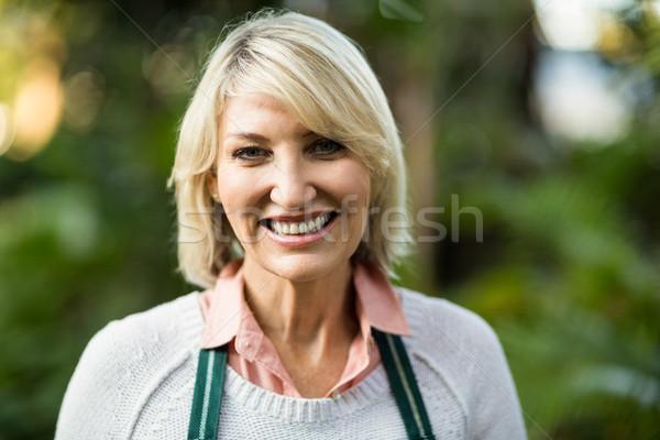 Portré mosolyog női kertész közelkép üvegház Stock fotó © wavebreak_media