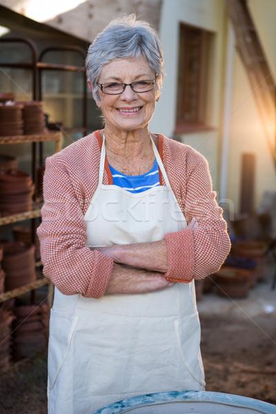 Happy female potter standing in pottery workshop Stock photo © wavebreak_media