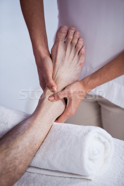 Physiotherapist giving foot massage to a patient Stock photo © wavebreak_media