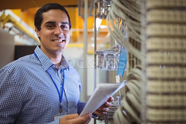 Portrait of technician analyzing server Stock photo © wavebreak_media