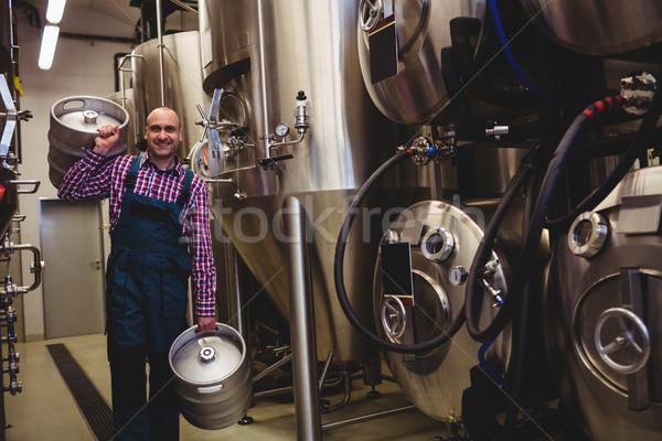 Portrait of brewery worker carrying kegs Stock photo © wavebreak_media
