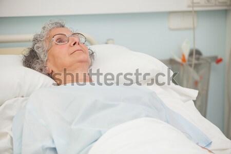 Upset patient sitting at medical clinic Stock photo © wavebreak_media