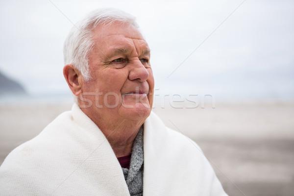 Kıdemli adam plaj müzik uygunluk Stok fotoğraf © wavebreak_media