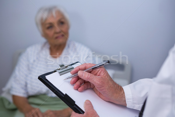 Doctor discussing medical report with senior patient Stock photo © wavebreak_media