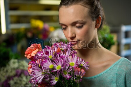 Mujer flores rosa cliente Foto stock © wavebreak_media