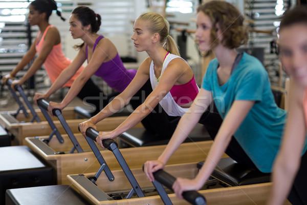 Group of women exercising on reformer Stock photo © wavebreak_media