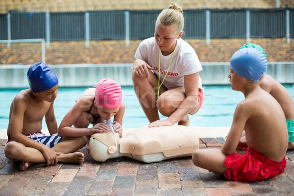 Lifeguard helping children during rescue training Stock photo © wavebreak_media