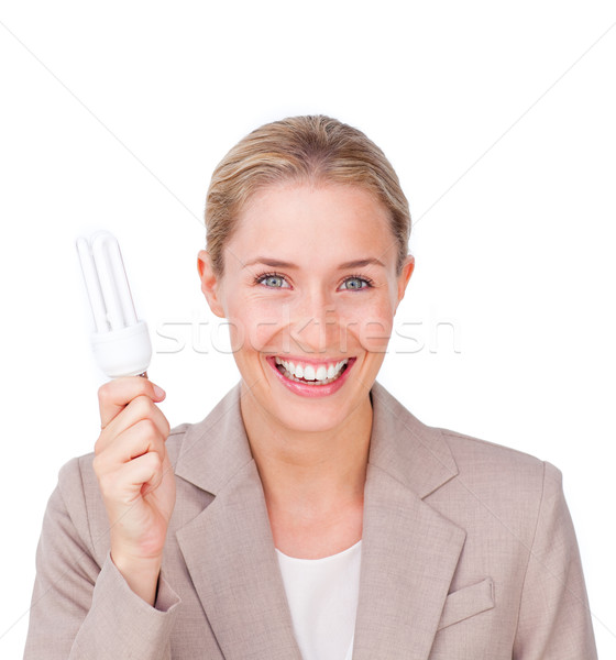 Positive businesswoman holding a saving energy light bulb  Stock photo © wavebreak_media