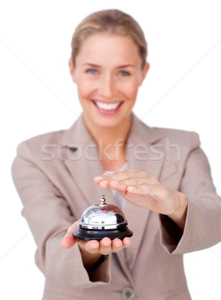 Smiling businesswoman holding a service bell  Stock photo © wavebreak_media