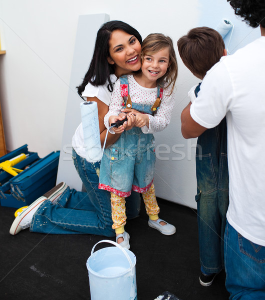 Portrait of little girl painting with her mother Stock photo © wavebreak_media