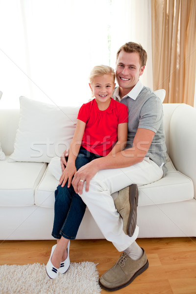 Blond little girl sitting on sofa with her father Stock photo © wavebreak_media