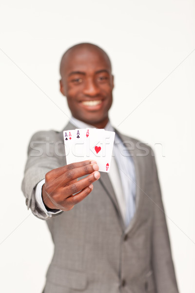 Attractive Afro-American businessman holding four aces Stock photo © wavebreak_media