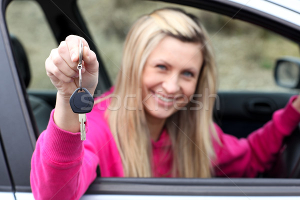 Smiling driver showing a key after bying a new car  Stock photo © wavebreak_media