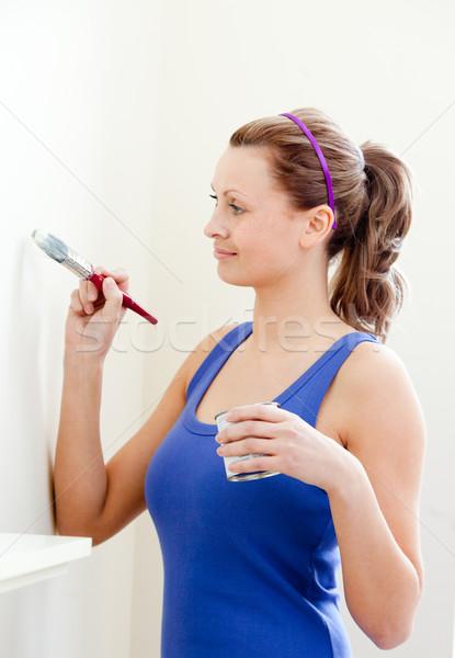 Beautiful woman is decorating a room  Stock photo © wavebreak_media