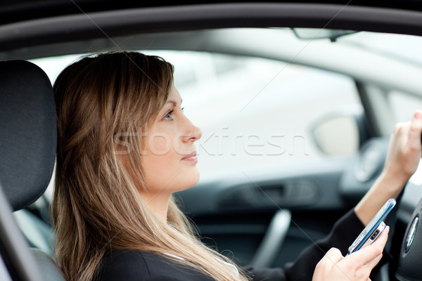 Attractive businesswoman sending a text while driving to work Stock photo © wavebreak_media