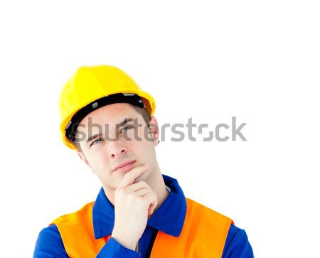 Pensive white collar worker with a hardhat against white background Stock photo © wavebreak_media