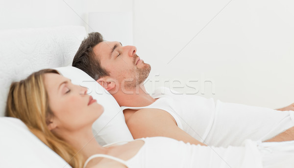 Calm pairs sleeping together at home Stock photo © wavebreak_media