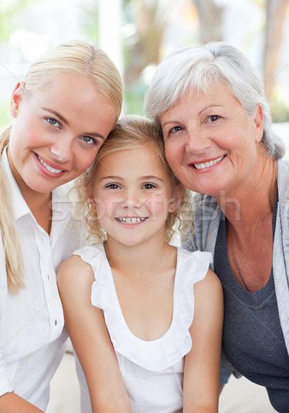 Ritratto gioioso famiglia guardando fotocamera home Foto d'archivio © wavebreak_media