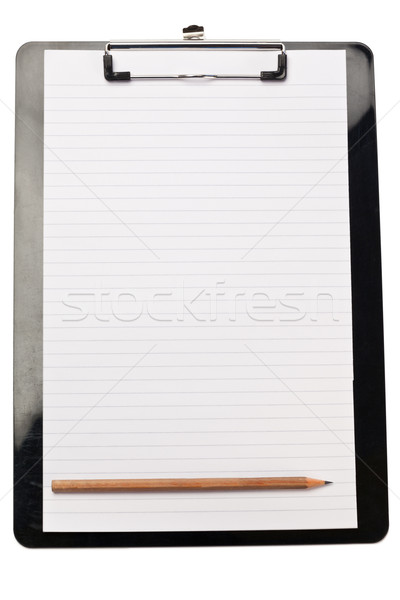 Pencil at the bottom of note pad on a white background Stock photo © wavebreak_media