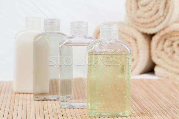 Close up of massage oil bottles and towels Stock photo © wavebreak_media