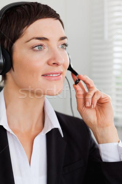 Portrait of a serious secretary with a headset in her office Stock photo © wavebreak_media
