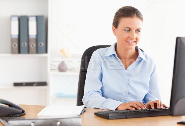Office worker typing on a keyboard in her office Stock photo © wavebreak_media