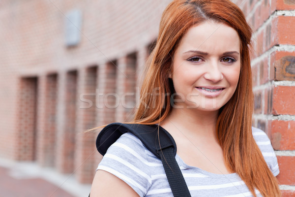Smiling student looking at the camera outside a building Stock photo © wavebreak_media