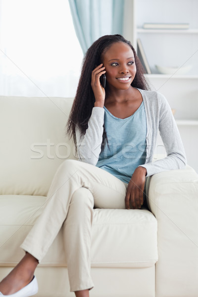 Close up of smiling woman with cellphone on sofa Stock photo © wavebreak_media