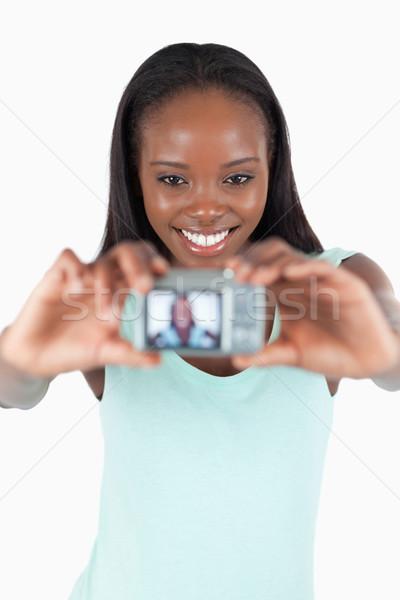 笑みを浮かべて 若い女性 写真 白 少女 ストックフォト © wavebreak_media