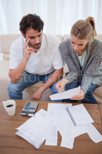 Portrait of a worried young couple doing their accounting in their living room Stock photo © wavebreak_media