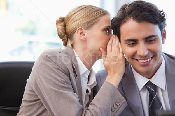 Fiatal üzletasszony suttog valami kolléga tárgyalóterem Stock fotó © wavebreak_media