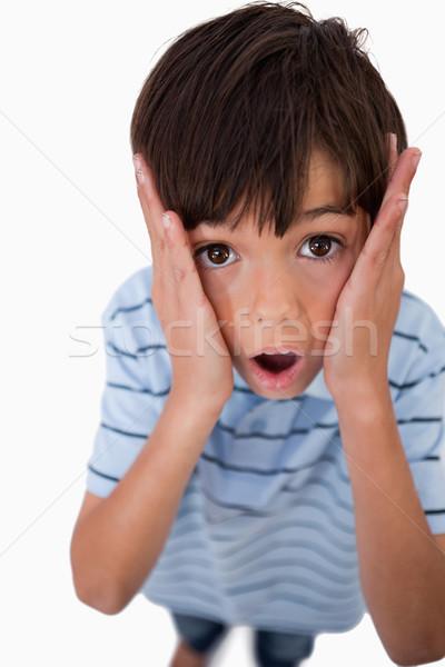 Ritratto scioccato ragazzo guardando fotocamera bianco Foto d'archivio © wavebreak_media