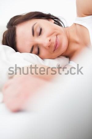 Mulher cama cabeça travesseiro desperto sorridente Foto stock © wavebreak_media